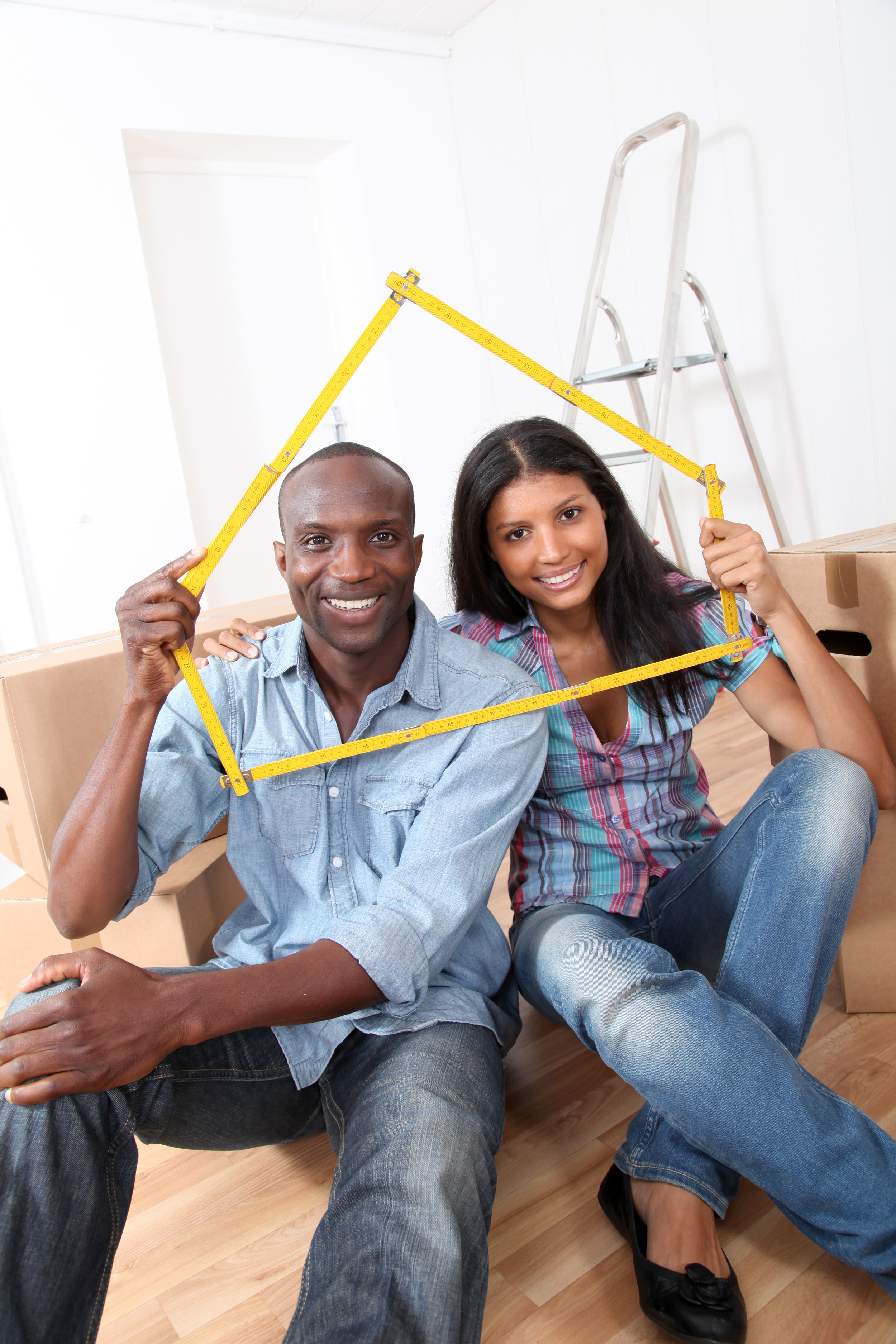couple holding house.jpg