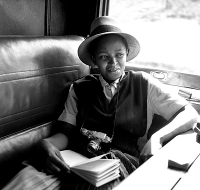 Dolly Rathebe on the Jazz Train. Photographed by Bob Gosani:http://www.baileyseippel.co.za/artists.php    More on Dolly: http://www.sahistory.org.za/people/dolly-rathebe