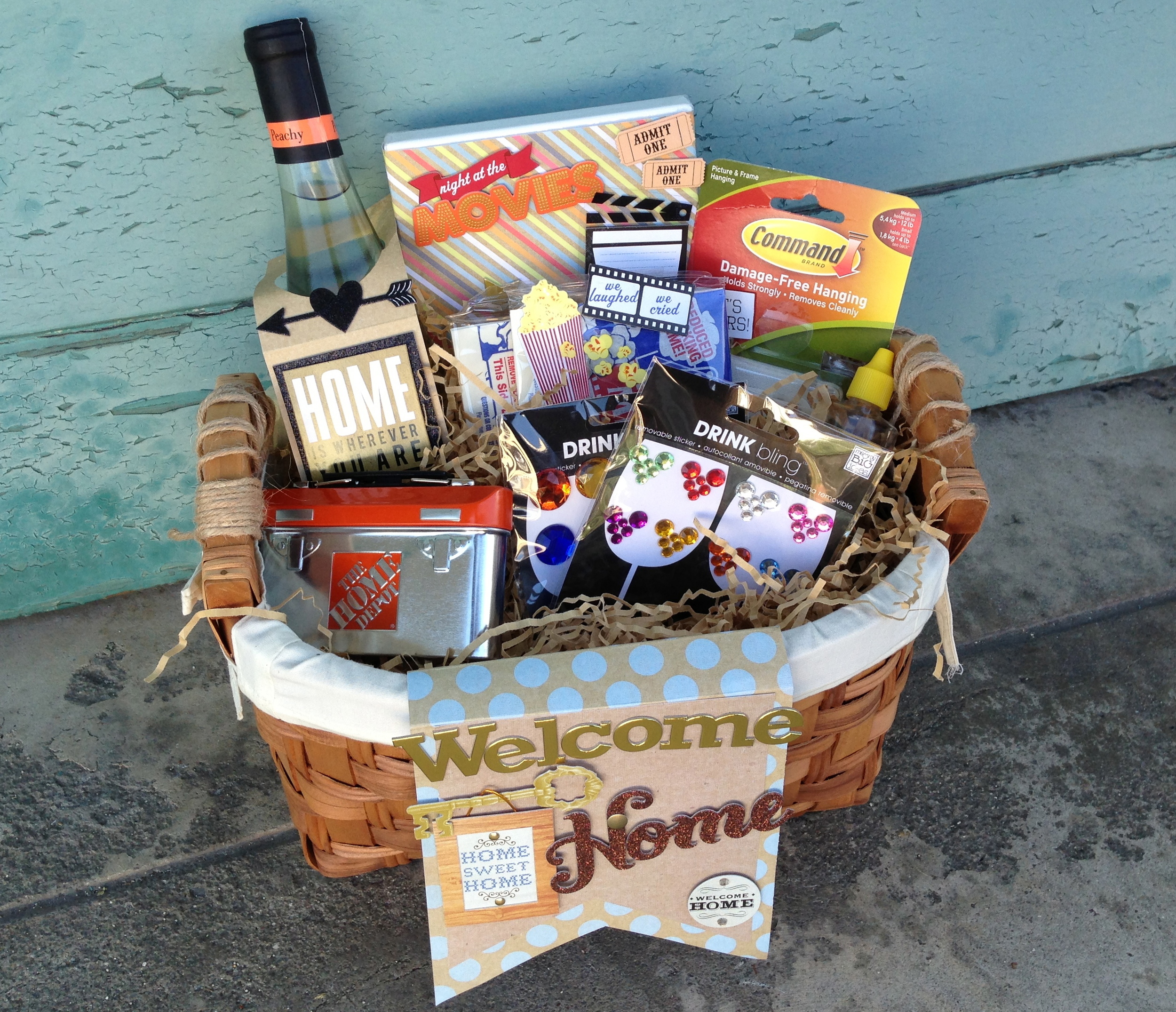 Housewarming gift basket on the mambi blog.  wine bottle cover, decorated wine bottle, popcorn, home depot gift card, drink bling.