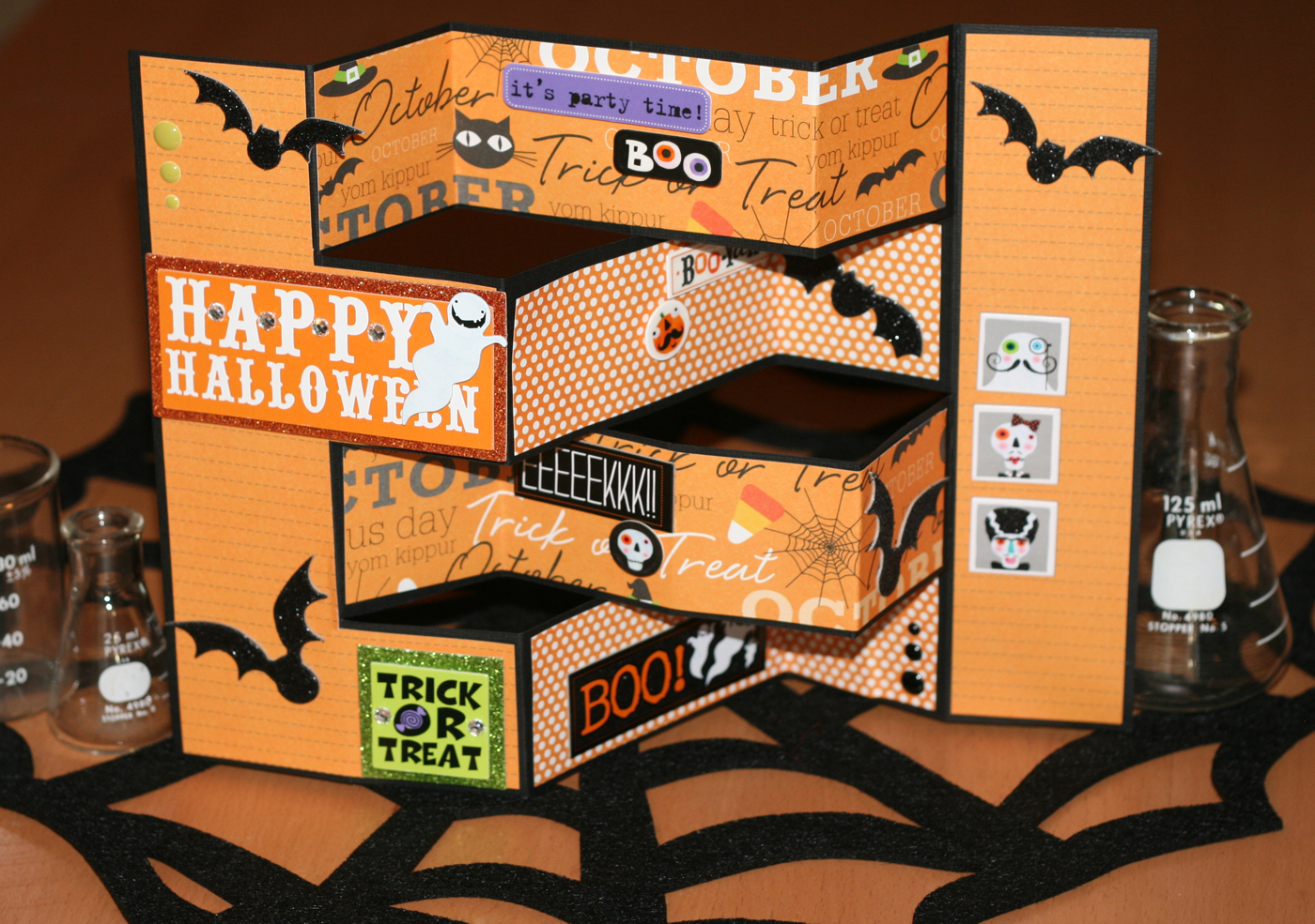 Halloween accordion card tutorial on the mambi blog.  Step by step video on how to make this fun pop card.