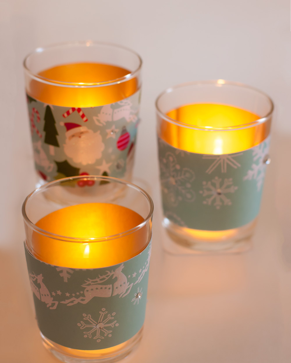 mambi glass candle votives on the mambi blog.  Just a paper pad, some rhinestones and some adhesive.  Fun DIY craft.