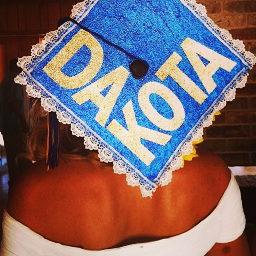 Gold capital alphabets on blue glitter graduation cap.  So cute and lace to tie it all together.