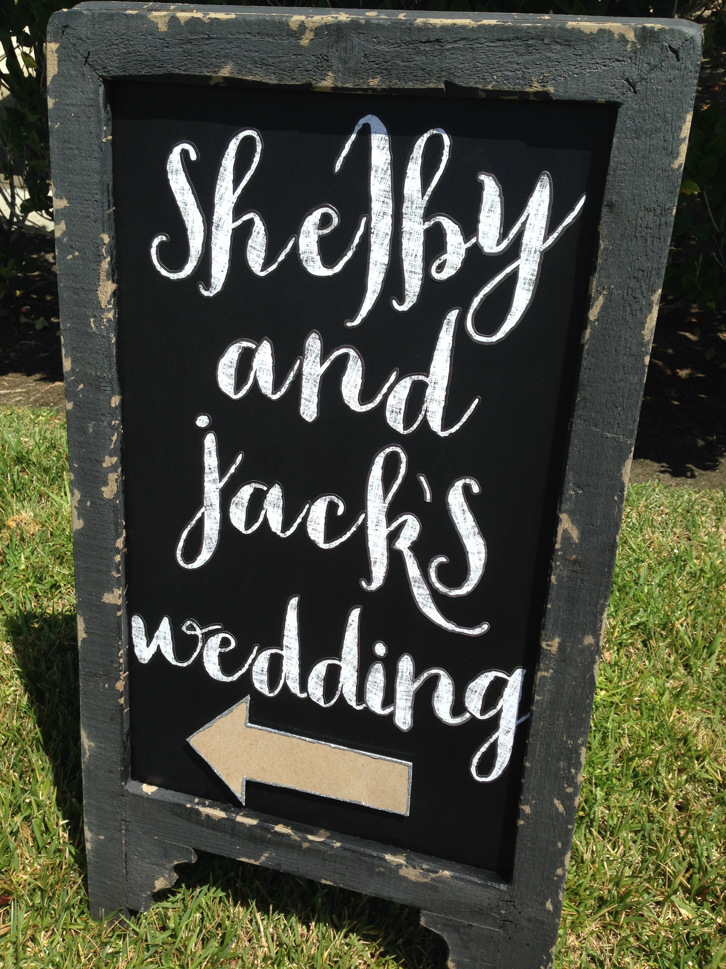 DIY wedding sign with mambi stickers and paper.