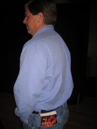 Jim suavely sporting PRETTY GIRLS in his back pocket