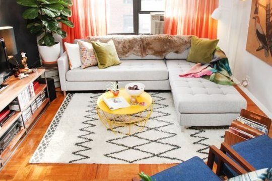 Refinery 29 knows how to pull off orange! I love how livable and (large?) this space looks. The height of the plant, the dreamy chaise for space saving seating- so pretty!