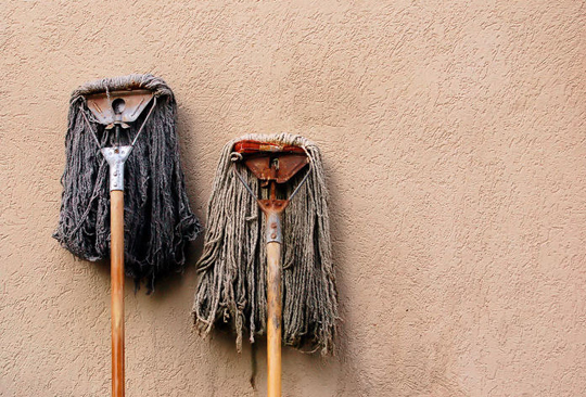 The horrible smell that an old mop has is the bacteria and germs it is growing.
