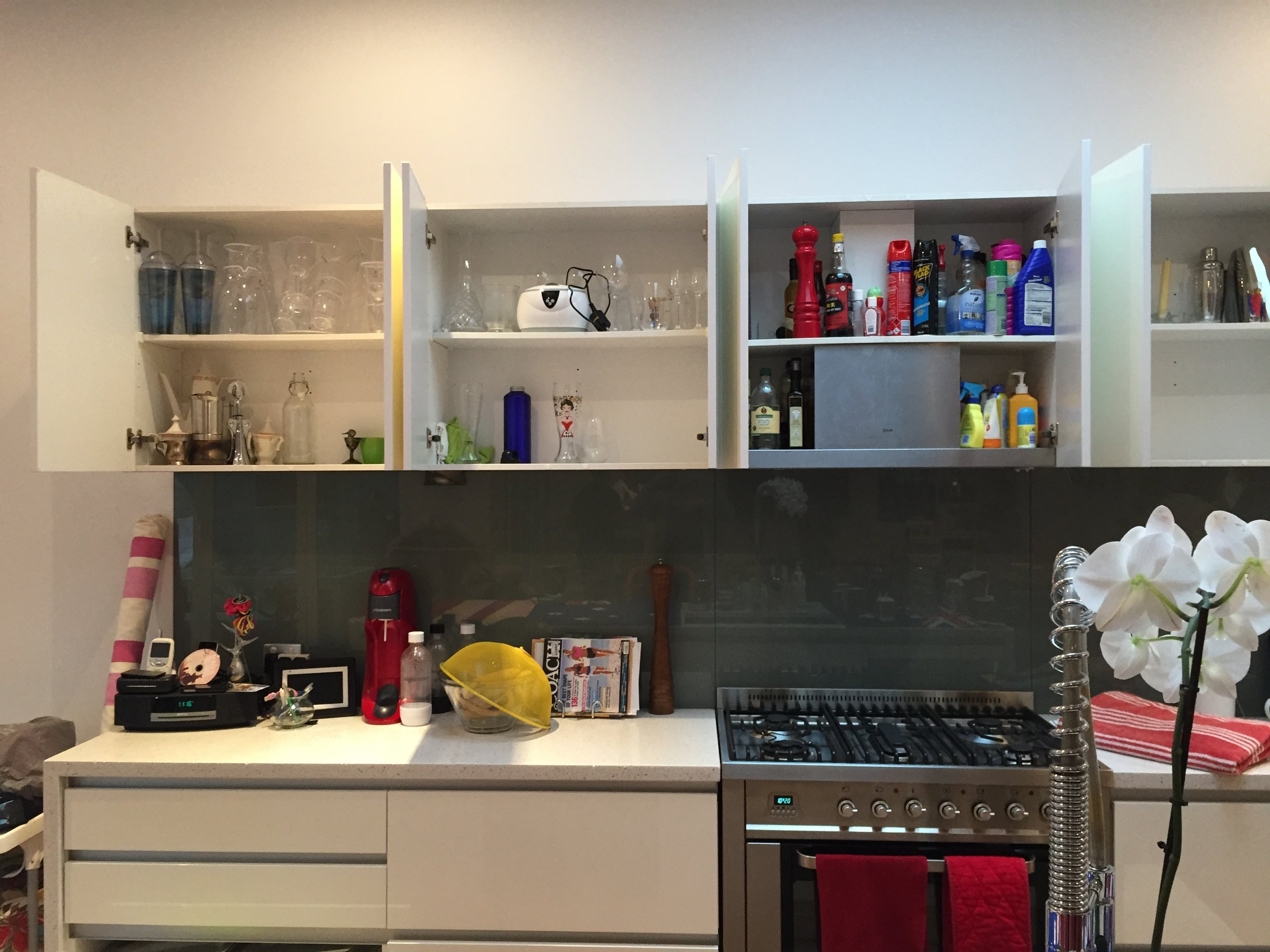 These cupboards are vital and easy to access, but they are full of things that the client rarely/if ever used. While, the coffee mugs and cups were all in one tiny end cupboard.