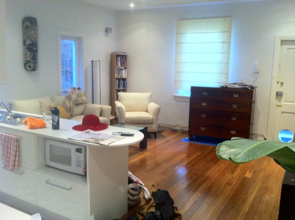 Before view of an unused living space with clutter. A lot of potential, beautiful furniture.