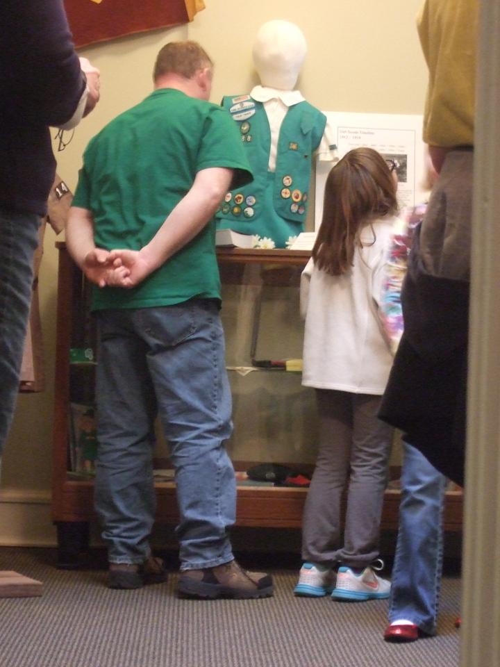 Enjoying the Girl Scout exhibit.