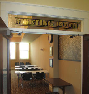 The MEETING ROOM is located on the first floor and has a kitchenette. It is available to rent for meetings and special events.