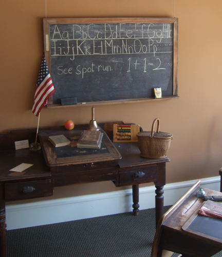 The chalkboard was hung at the front of the room, and students would be asked to come to the board and write the answers to questions in the related subject in which they were learning.