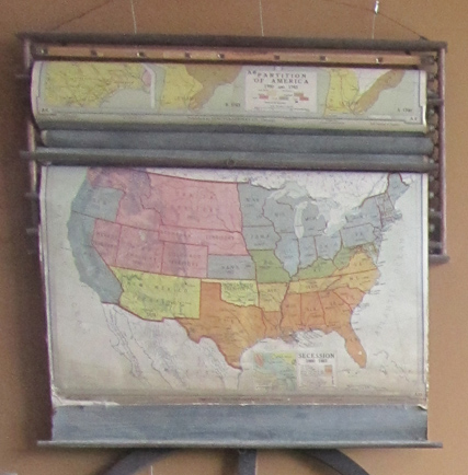 Sets of roll-down maps were hung on the wall in the front of the room. During geography class, the specific map would be rolled down so students could study them. This map set was used at the Springville School.