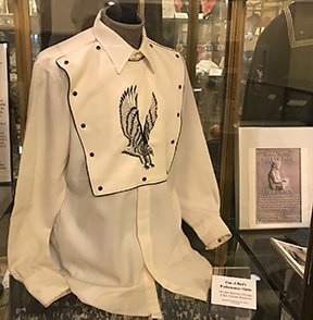 One of Bud Isaacs' performance shirts is included among many other mementos in the exhibit.