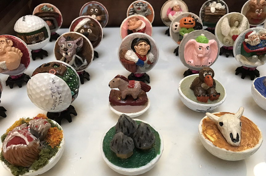 Charles Walters used pictures, models and freehand ideas to create these captivating carved golf balls.