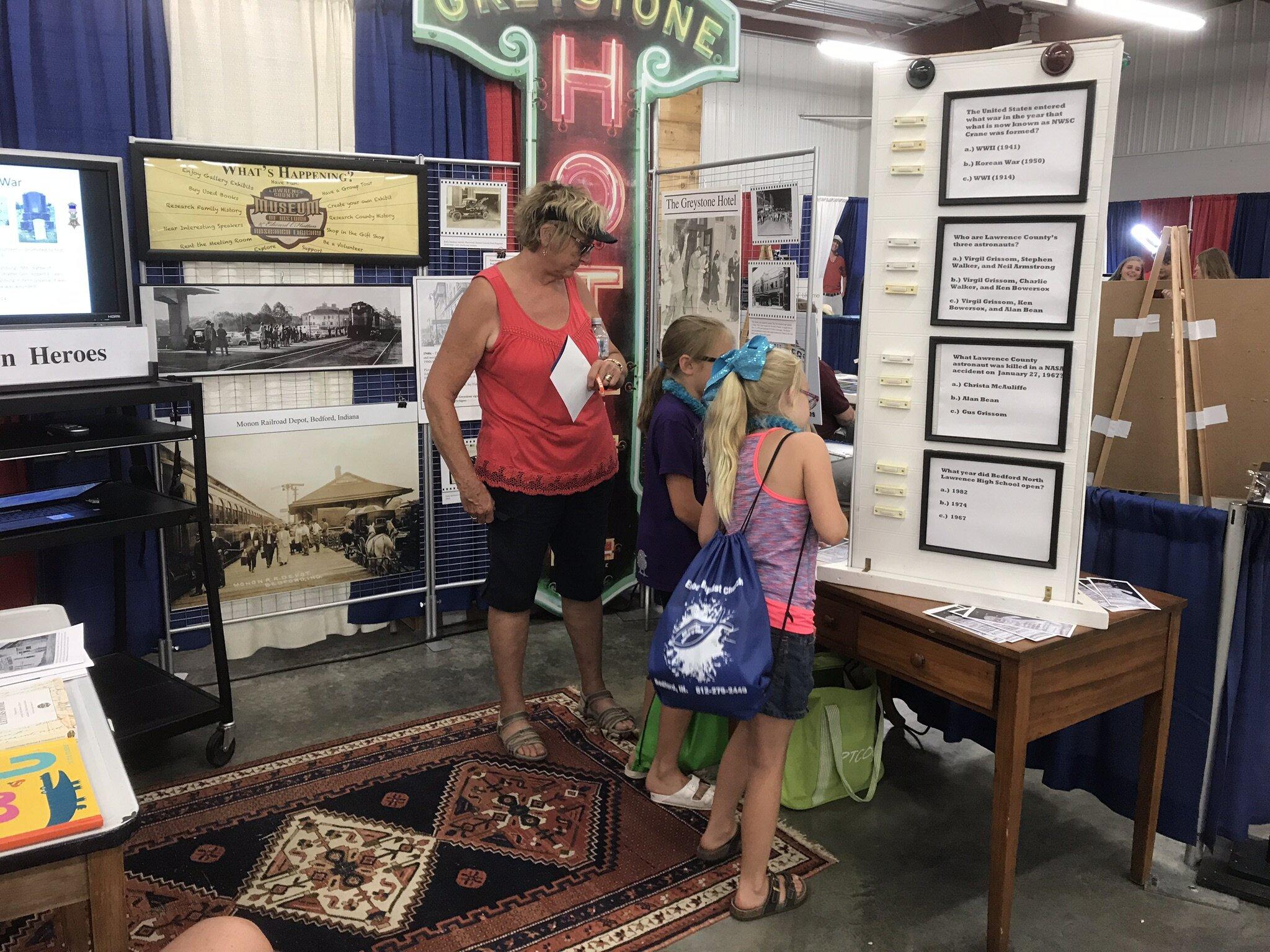 Visitors enjoying the low tech question machine.