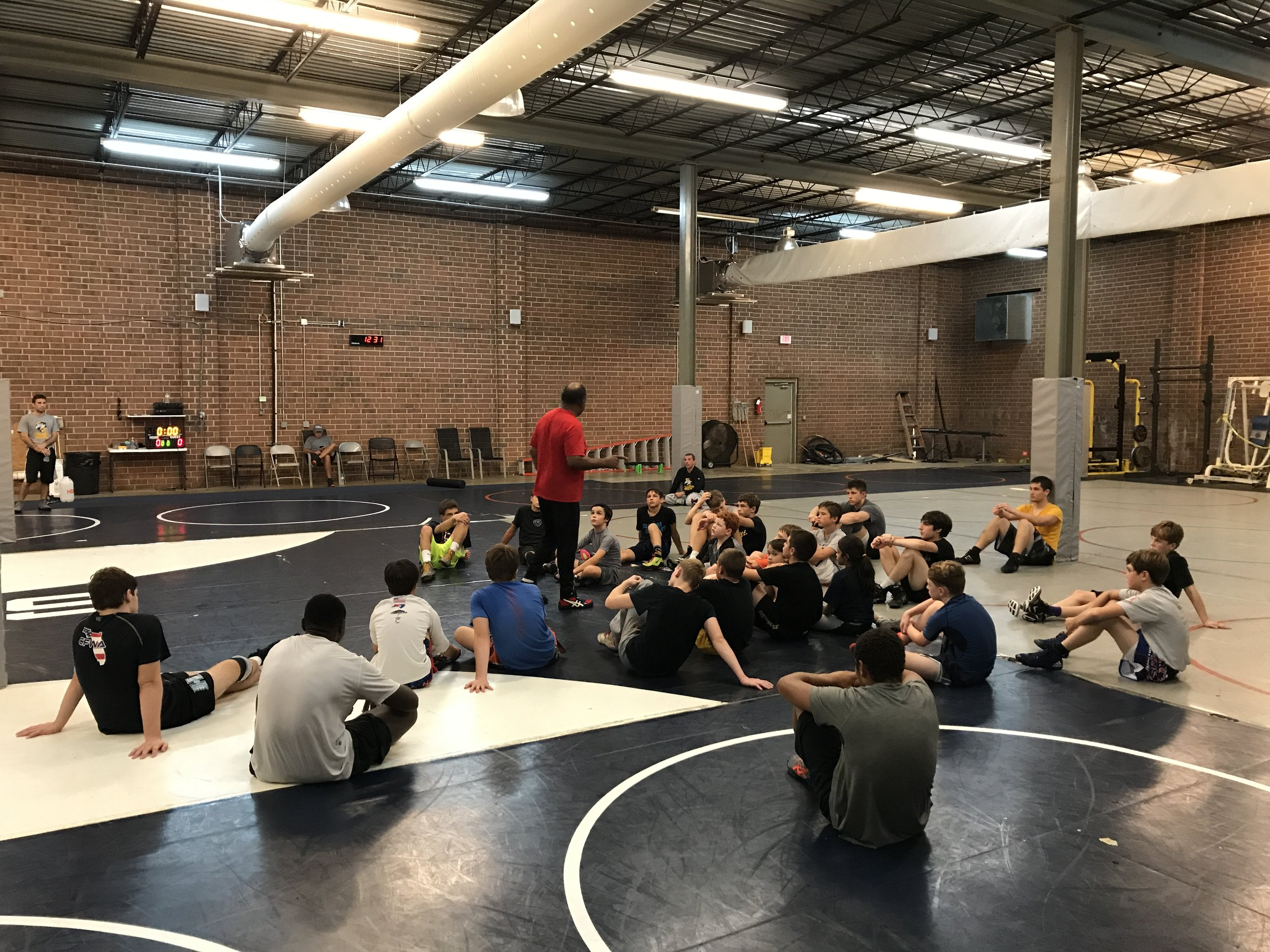 "Visiting Coach Carl Adams - Teaching a small group of wrestlers at the ""Back to School"" Summer Camp. Coach Adams is a legend in our sport - an NCAA Champion, World Team Member and a long standing Div. 1 College Coach!"