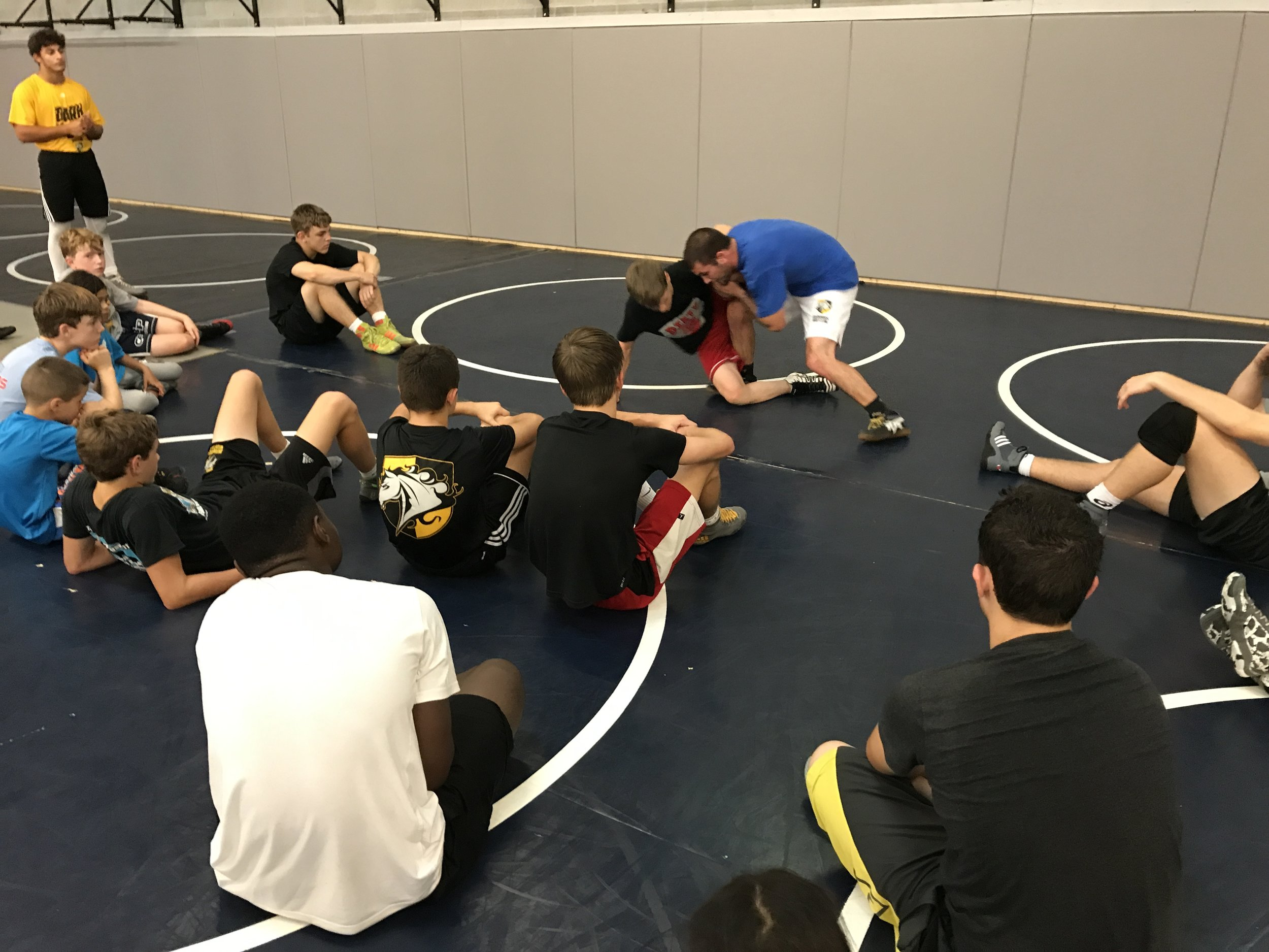 Visiting Coach Sean Boyle demonstrating single-leg finishes.