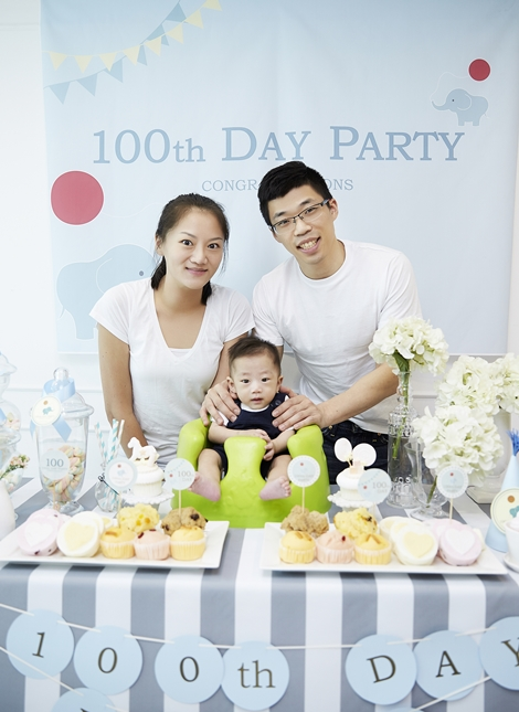 A Korean family celebrating their child's 100th day,  baek-il.