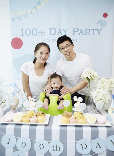 A Korean family celebrating their child's 100th day, baek-il.