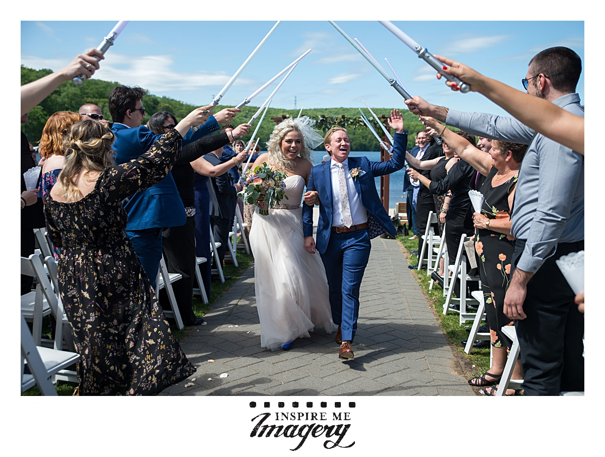 Light sabers!! The bride and groomswoman got to walk under light sabers!