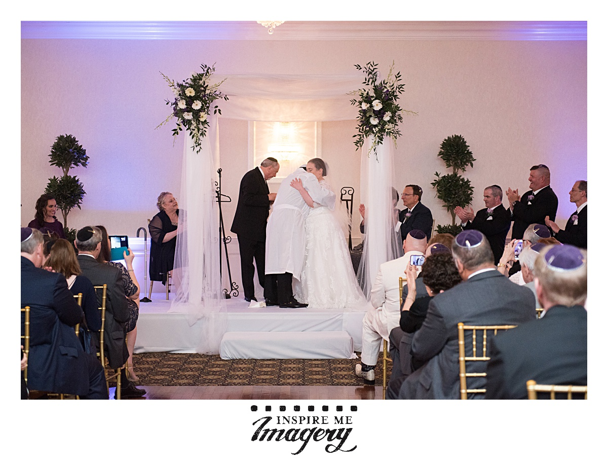 The ceremony concludes and the bride and the chosson and kallah embrace.