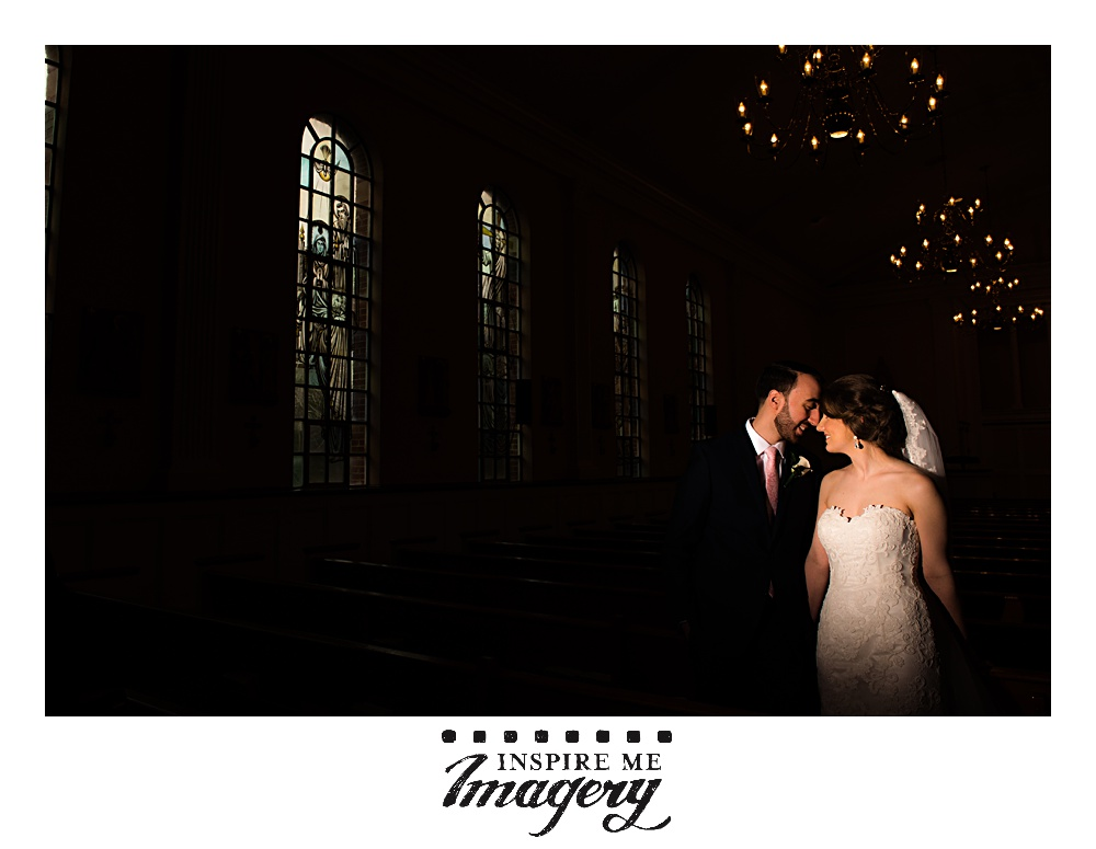 A quick dramatic portrait in the church before heading out to the wedding reception.