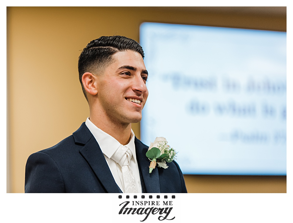 The groom waits to see his bride for the first time.