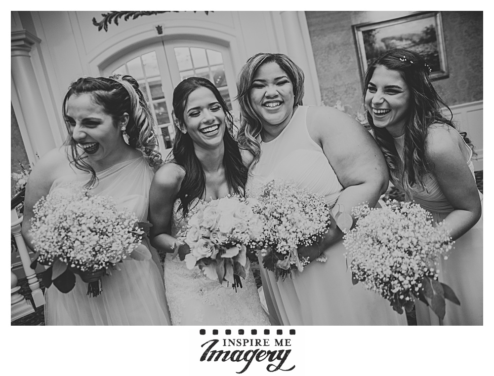 The bride laughs with her girls before cocktail hour begins.