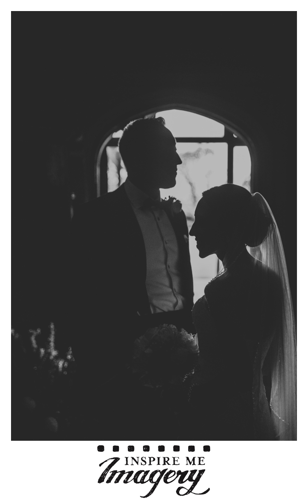 A silhouette of the bride and groom in a corridor at Skylands Manor.