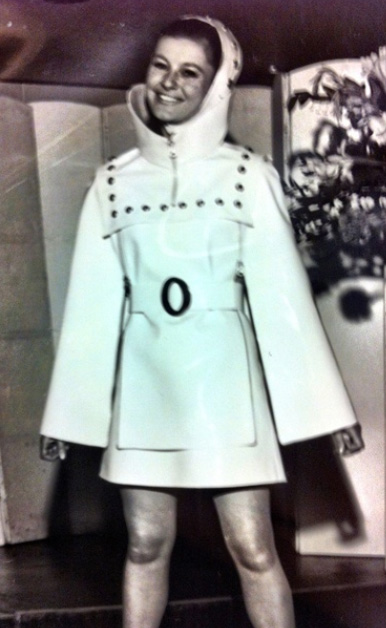 Photograph of young woman in short raincoat with a hood and ankle - length boots, designer unknown, 1963-69, Archive's code: SA/AT/26/12/30