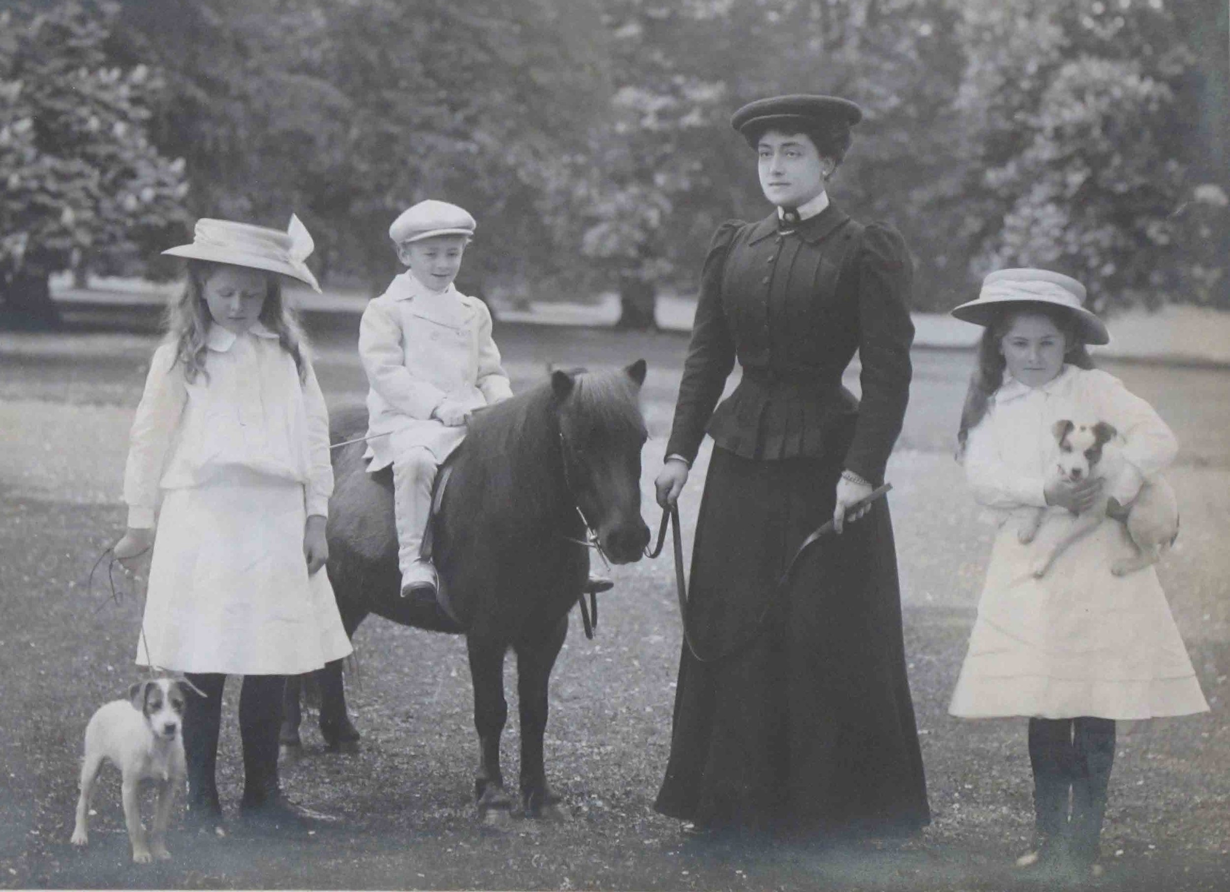 Photograph of Henrietta Bankes with her three children, Kingston Lacy estate, Dorset, 1908.