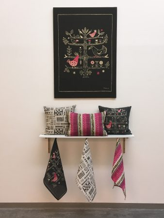Wall hangings, tea towels and cushions available to buy from GSA shop, 2017.