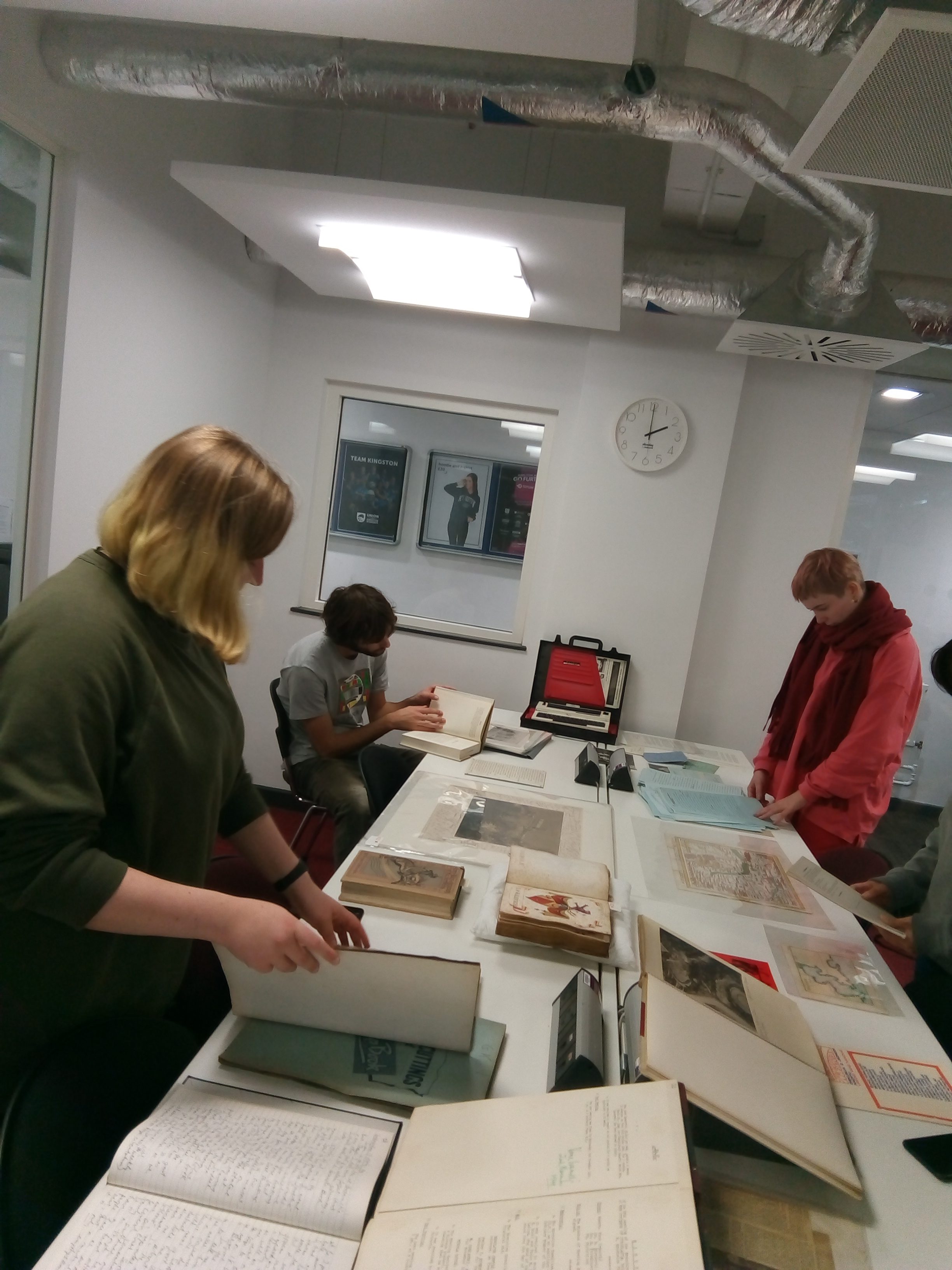 Students researching the life of Vane Ivanovic in Kingston University Archives, 2018