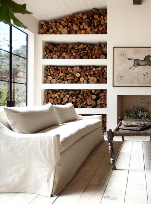Love the organic feel of all the wood storage. I don't hate that couch either!