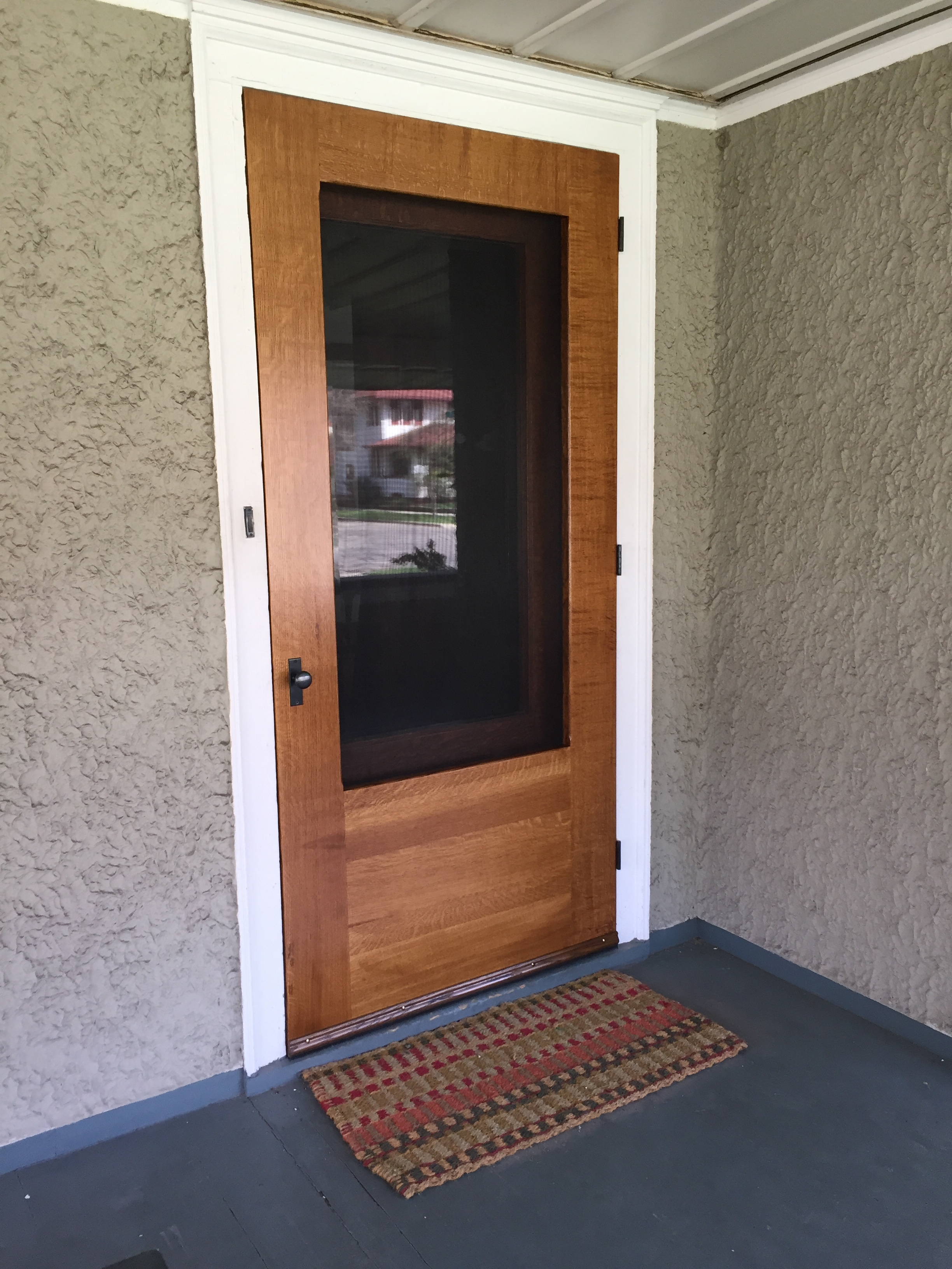 A custom quartersawn white oak storm door completed by HomeCure in 2016.