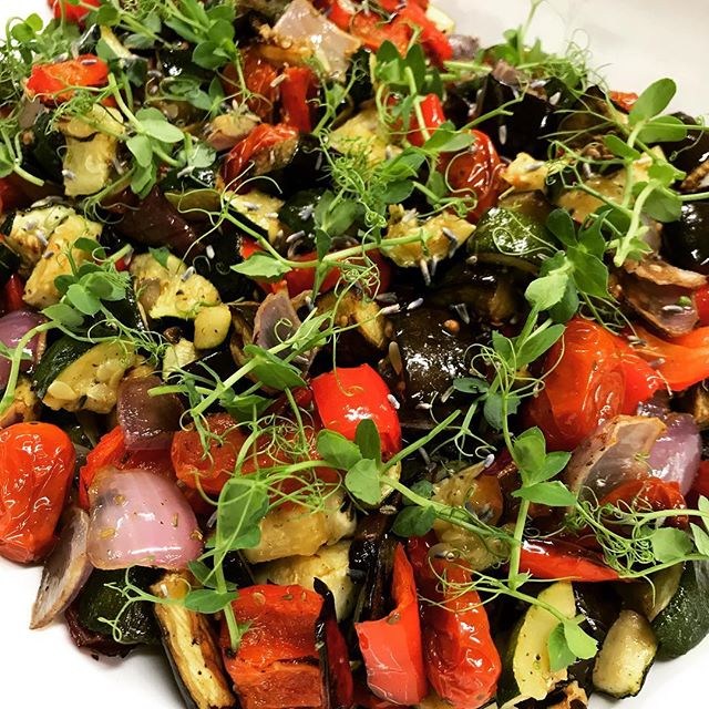 Roasted ratatouille is one of our favorite side dishes. We put our spin on this classic dish by individually roasting each component and then mixing them together once cool. A generous sprinkle of dried lavender, thyme and sea salt. Curly pea tendrils for fashion and flair. Simple, healthy, delicious! #ratatouille #lunch #lunchcatering #vegetables #vegan #veganfood