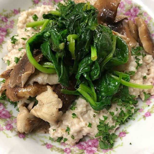 Breakfast. Of. Champions. 🏆 Savory steel cut oats with a spoonful of tahini, fresh garlic and herbs. Topped with sautéed shiitake mushrooms and spinach. Some crispy bacon or a fried egg on top of this would be ridiculous. #breakfast #veganbreakfast #oatmeal #savoryoatmeal #breakfastofchamps #steelcutoats