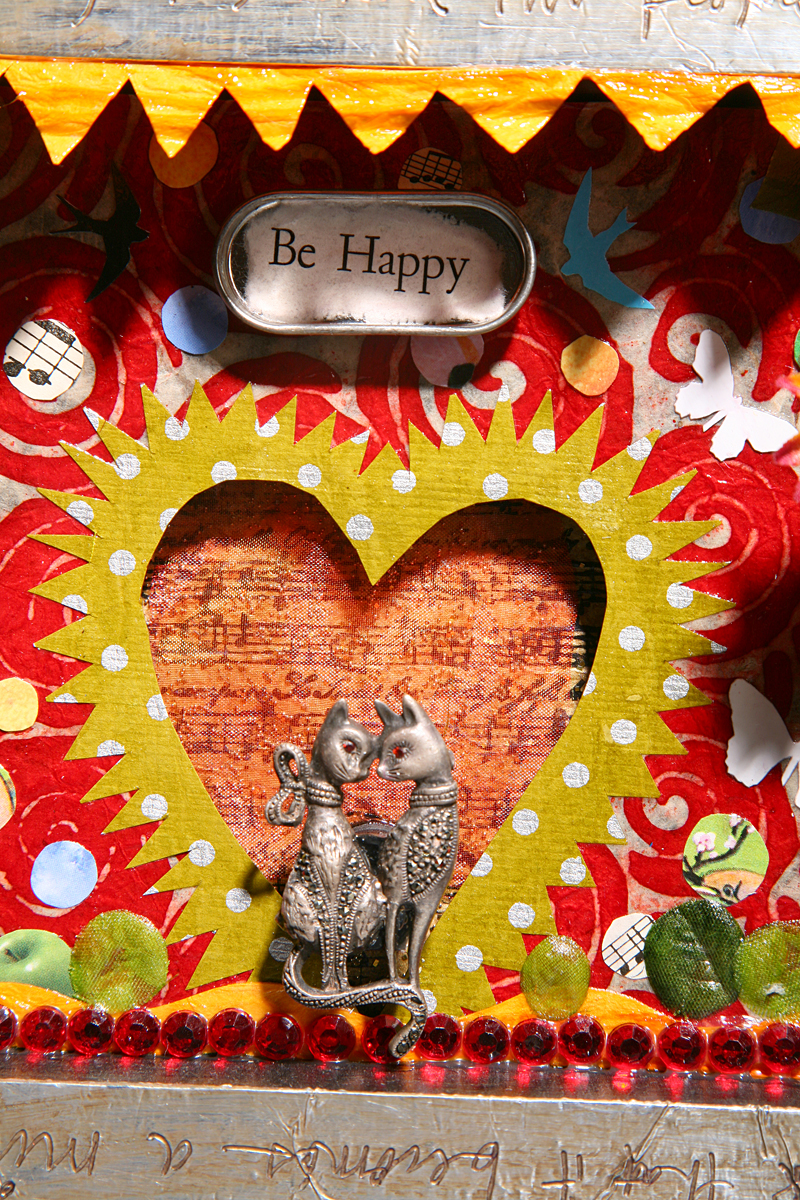 """detail of """"Be Happy"""" mixed media assemblage by sara saltee."""