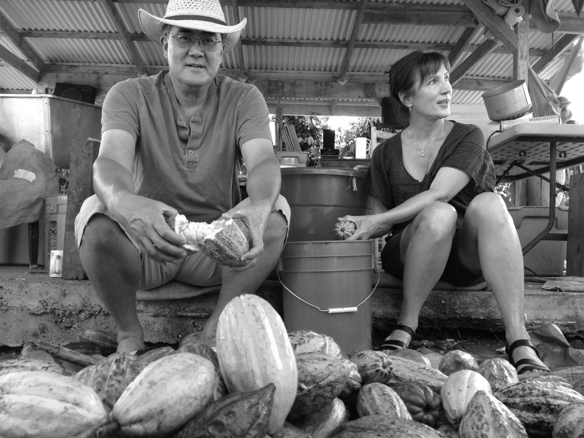 Andy and Jo with a cacao pod harvest