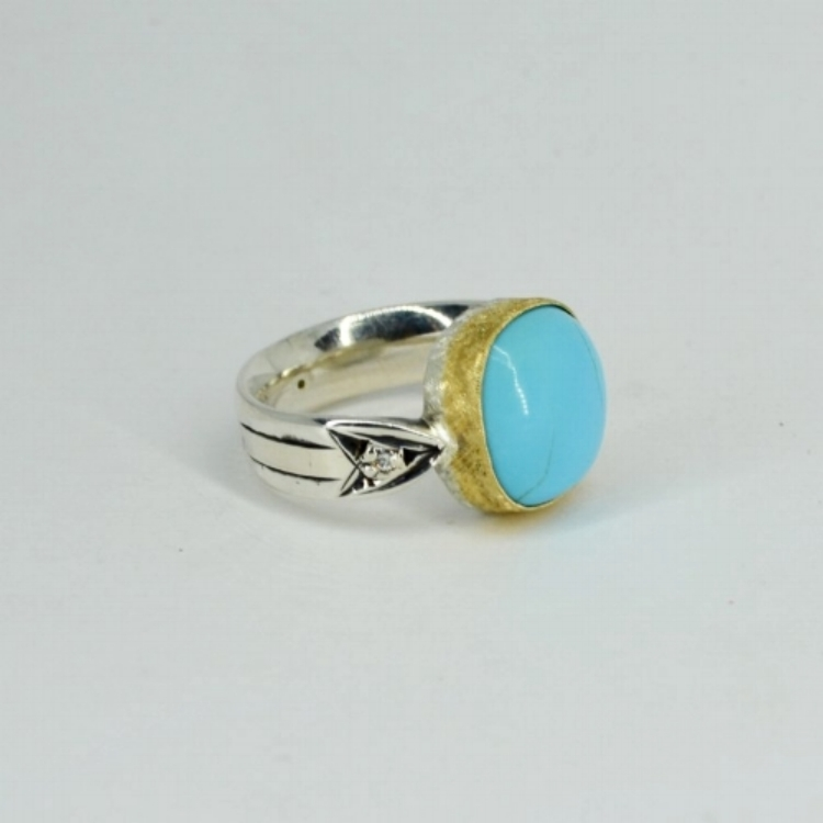 HEIRLOOM TURQUOISE ARROW RING   Yet another treasure from the workbench of Sofie Albertsen, The  Heirloom Turquoise Ring  is a one of kind beauty, with turquoise and diamonds, set in 22k florentine gold with hand engraved sterling silver band.   In store and online now.