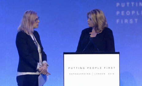 Alexia Pepper de Caires (left) delivers remarks during   UK Minister Penny Mordaunt's keynote speech at the International Safeguarding Summit.  (Photo: Screenshot of DFID International Safeguarding Summit)
