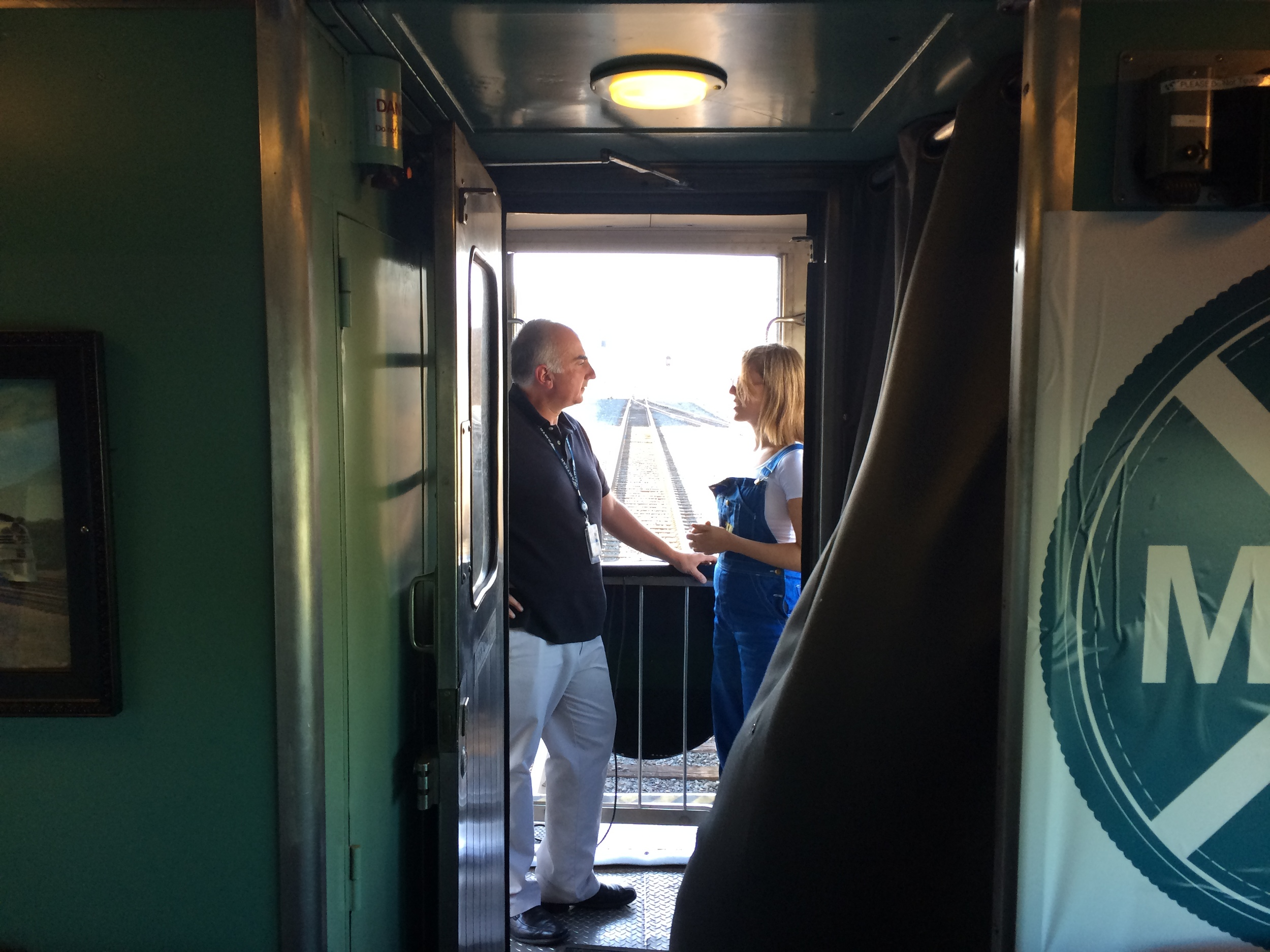 "8/10/14  | Mentor Rob Eaton of Amtrak talks to MTP Participant Jenny Gottstein as we ride through Montana. ""Trains are cool, but what's really cool is what they can do for our communities,"" he said."