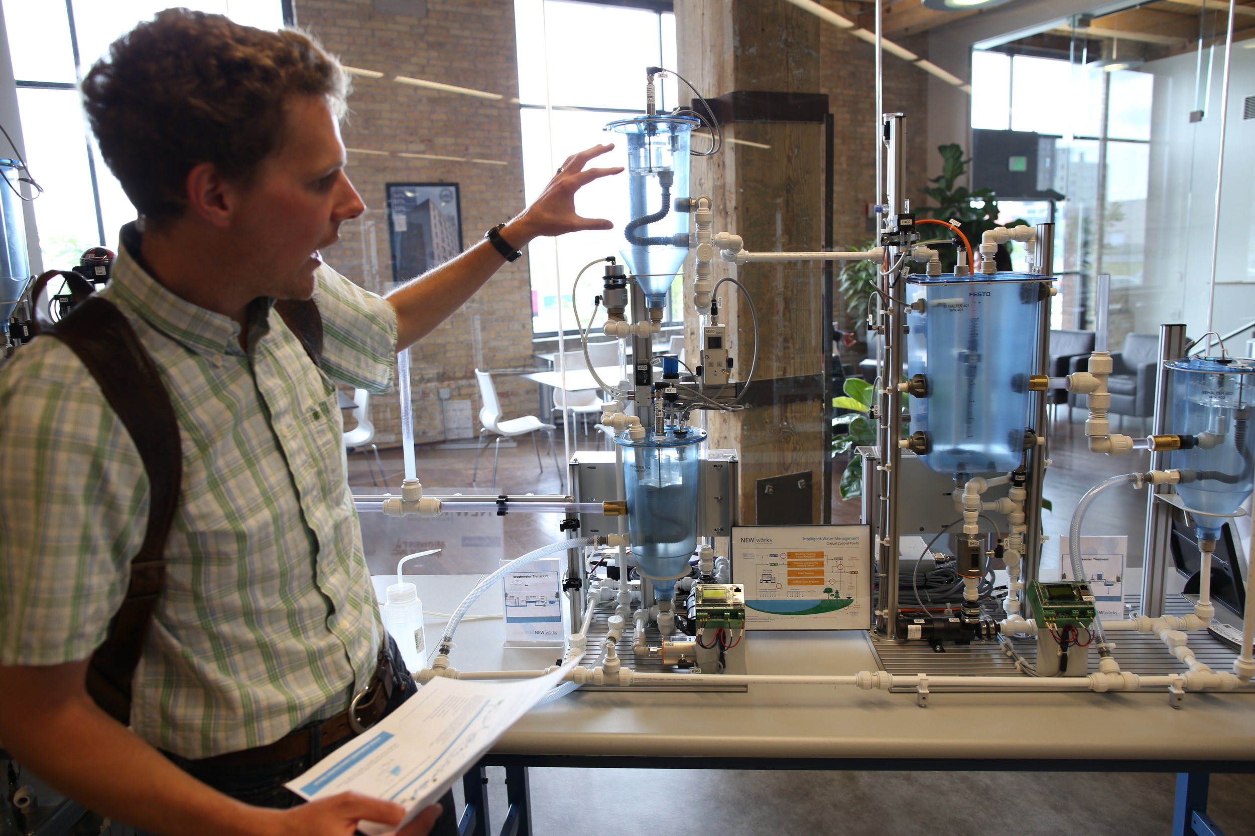 8/13/14  | MTP participant Nate Conroy explains a water filtration device that he uses to as a teaching aid help students develop science, technology, engineering and math skills. (Credit: Tyler Metcalfe, National Geographic Travel)