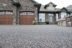 What is Rubber Paving? - Rubber paving is a cost effective way to resurface your cracked and damaged driveway, sidewalks and patios. It is made of recycled materials and can be installed right over your old concrete creating an attractive and distinctive looking surface.
