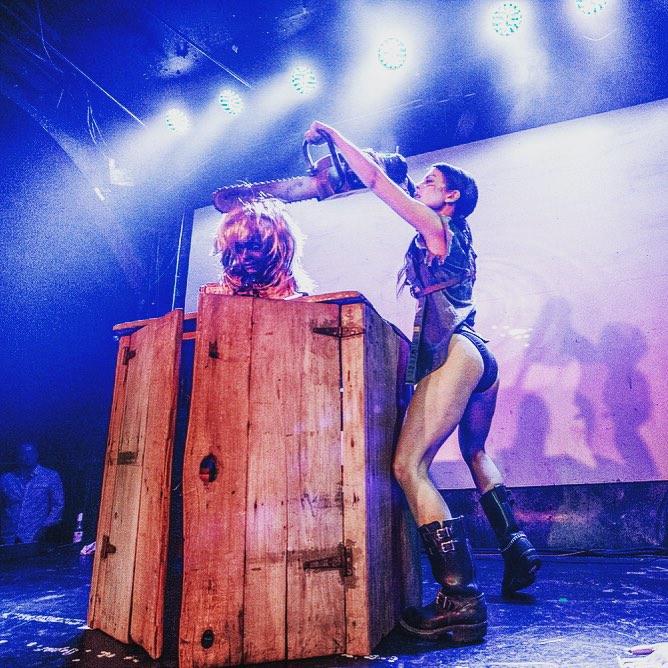 Diamondback Ash sawing girlfriend Linda's head in half. Photo by Gil Riego.