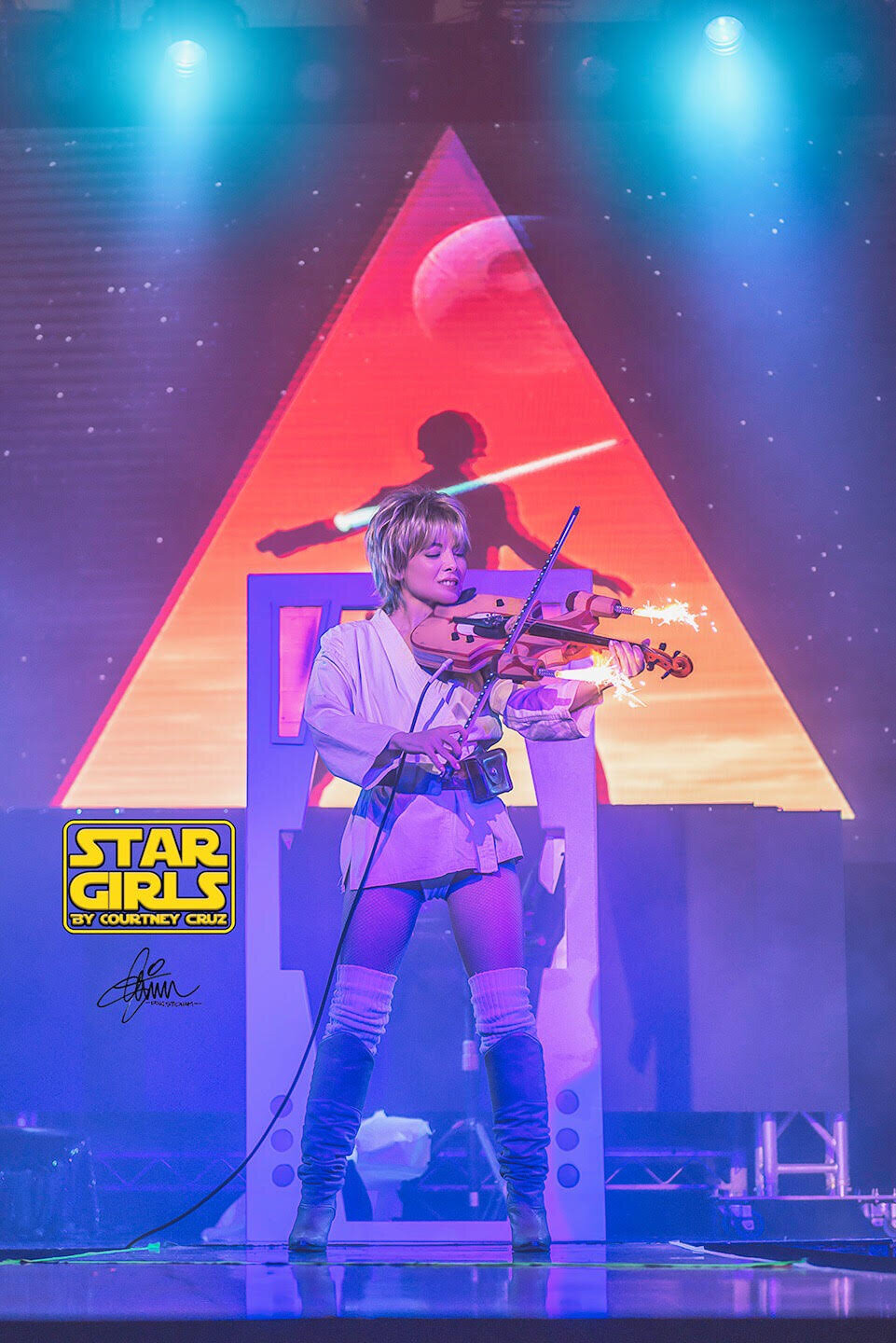 Diamondback plays the National Anthem on an electric violin with fireworks for jets at the Globe Theater in Downtown LA. (photo by Doug Stidham for Devil's Playground LA / violin by Carlos Flores / lighting design & projections by Jöel Huxtable