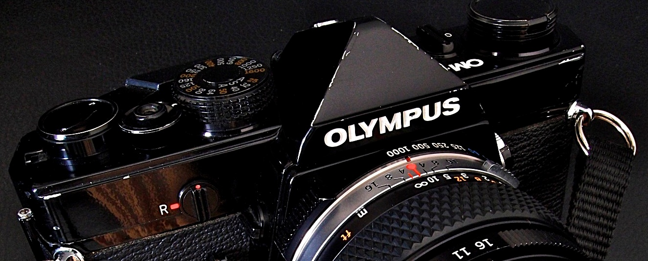 Originally presented at photokina 1972 as the M-1, designed by Yoshihisa Maitani as the smallest and lightest SLR of its time, the all-mechanical, TTL exposure camera was launched in 1973 as the OM-1 after complaints by Leica. Became the OM-1MD in 1974 to accommodate motor drive