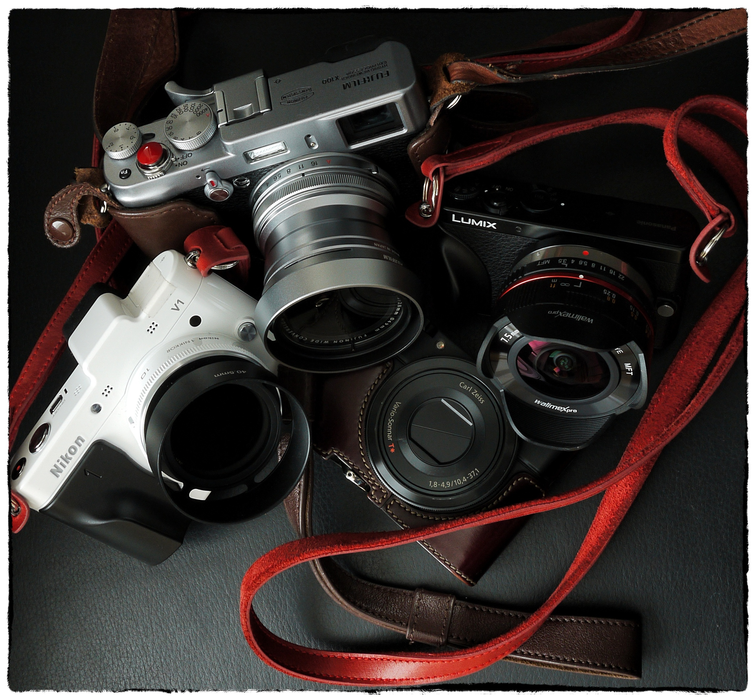 Trusty and comparatively weightless cameras, the Fuji X100 seen here with 28mm equiv. wide angle supplementary lens