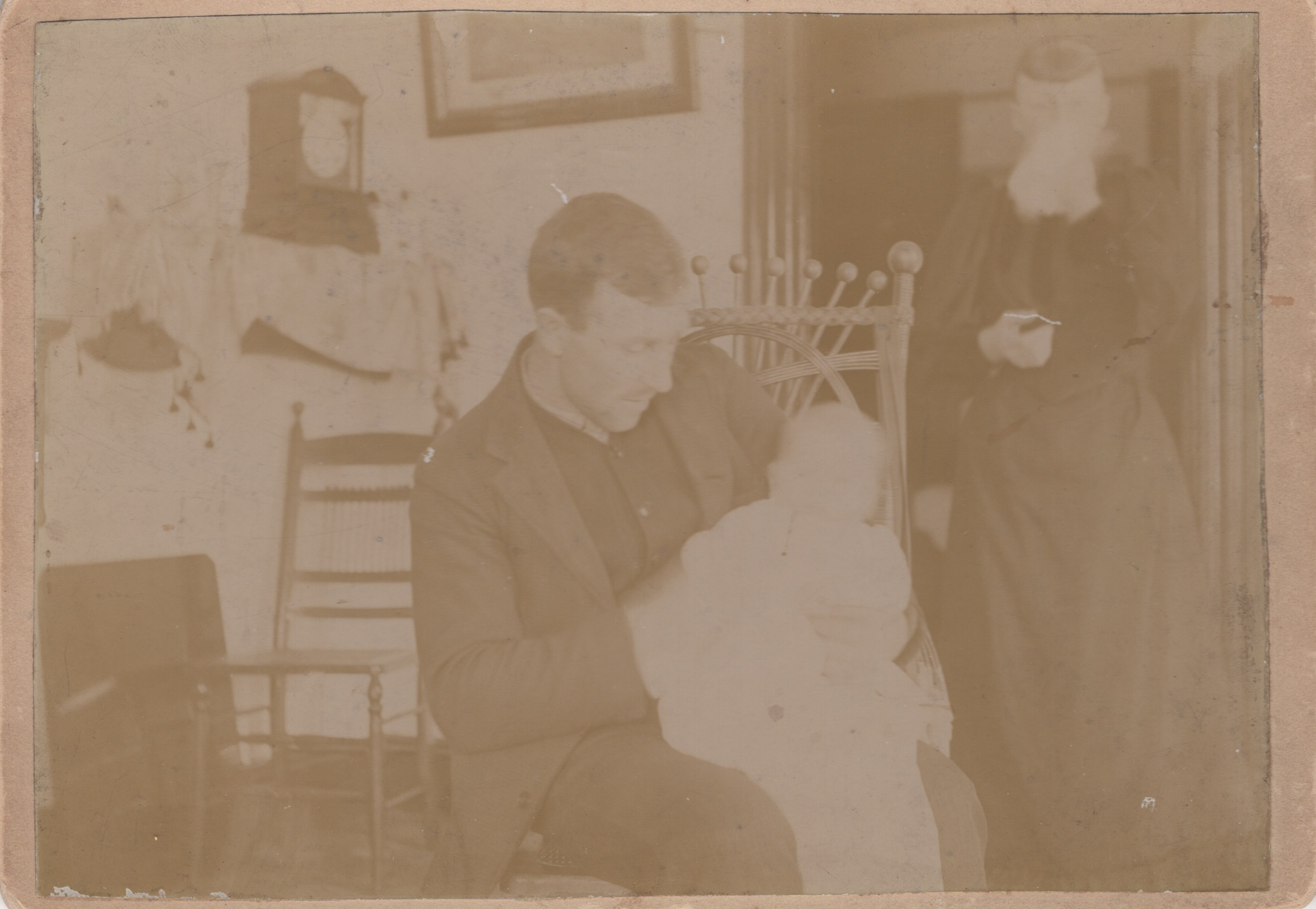 Charles I Young Sr holding Baby Frank Young, Wife Mary in Background