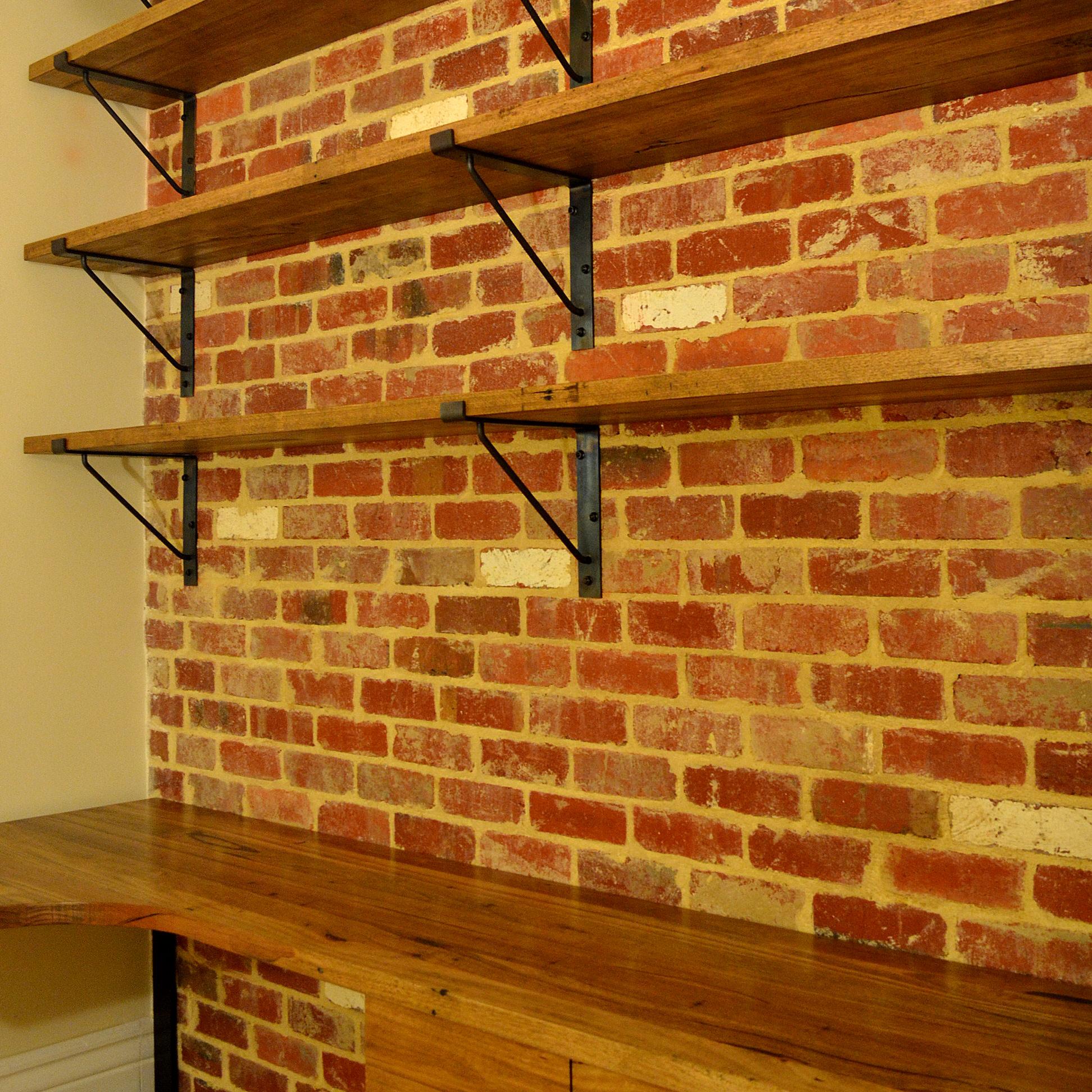 Custom Steel Shelf Brackets On Brick Wall